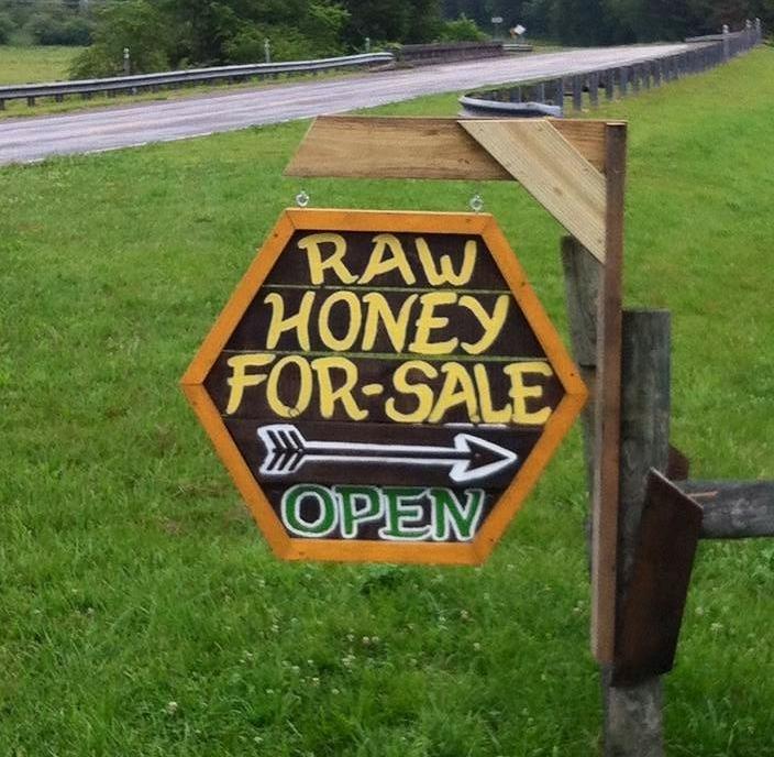 Local beekeeper's roadside honey sign for roadside honey stand.